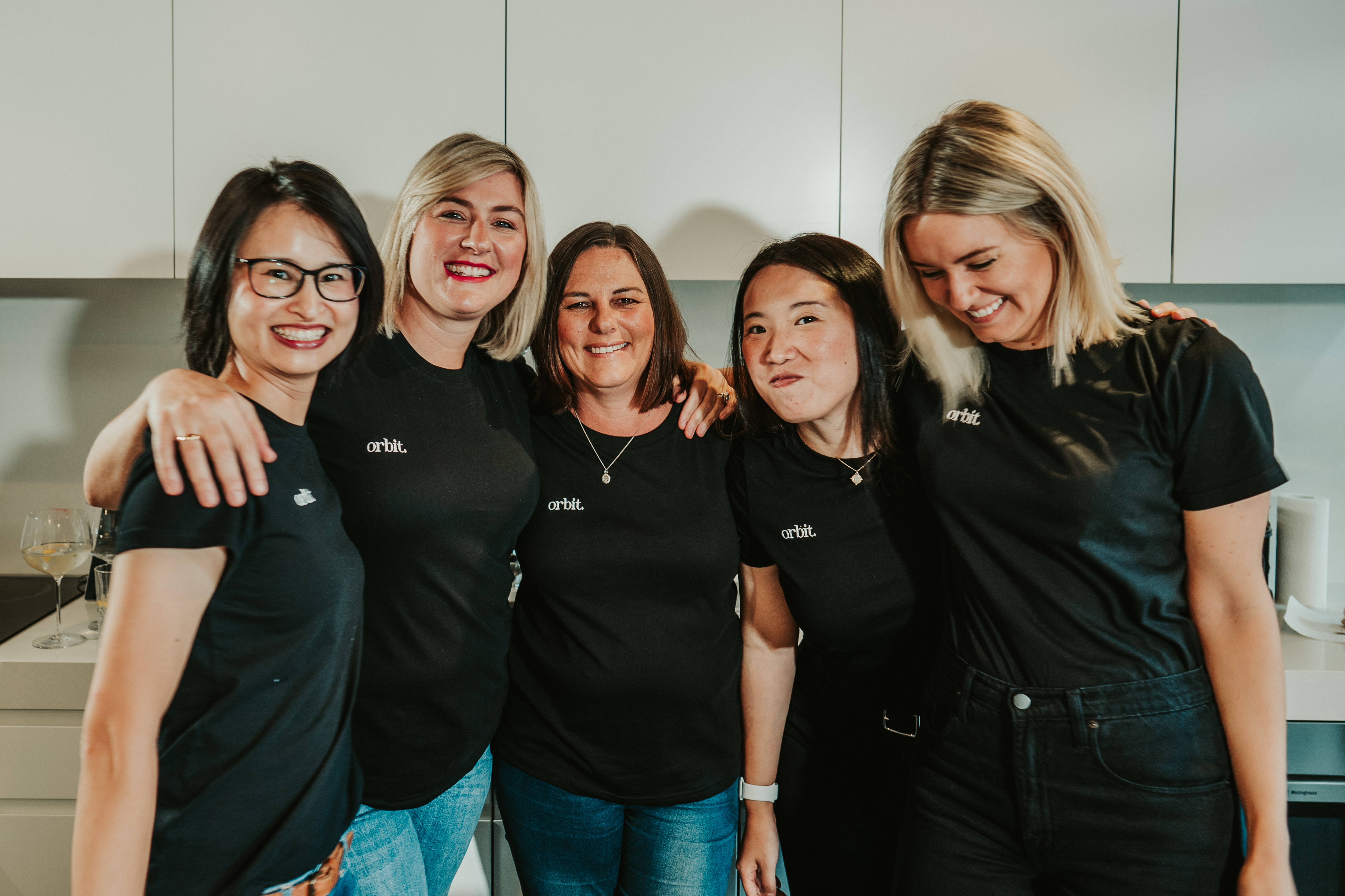 Orbit Team Hugging And Laughing In Sydney Office (pre Covid)